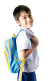 Little student boy in uniform on white background Royalty Free Stock Photography