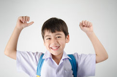 Little student boy in uniform on white background Royalty Free Stock Images