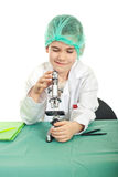 Little student boy using microscope Stock Images