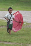 Little Student boy walking in his school. Royalty Free Stock Photography