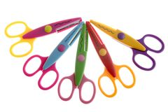 Little student colorful plastic scissors. Isolated over white Royalty Free Stock Image