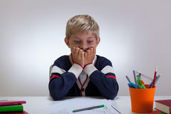 Little student with difficult task Royalty Free Stock Images