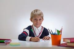 Little student doing homework Royalty Free Stock Images
