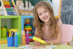 Little student girl at art class stock images