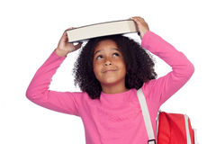 Little student girl with a book on her head Stock Photos