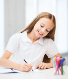 Little student girl drawing at school Royalty Free Stock Photo