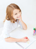 Little student girl drawing at school Stock Image