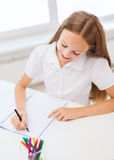 Little student girl drawing at school Stock Photo
