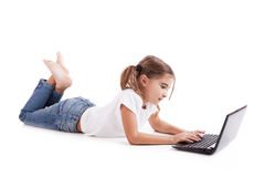 Little student girl with a laptop Stock Image