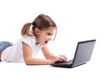 Little student girl with a laptop Stock Photos
