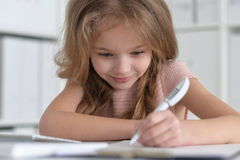 little student girl making homework Stock Photography