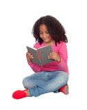 Little student girl reading Royalty Free Stock Images