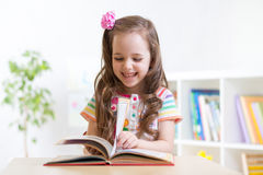Little student girl studying at preschool Royalty Free Stock Photography