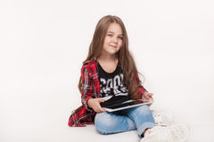 Little student girl with tablet pc doing homework Stock Photos