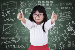 Little student girl with thumbs up stock photo