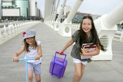 Little student girls going to school in city Royalty Free Stock Image