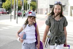 Little student girls going to school in city Stock Photography