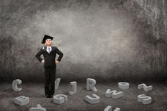 Little student on grey with letters under his feet Royalty Free Stock Photos
