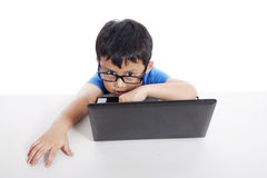 Little student with laptop Stock Image