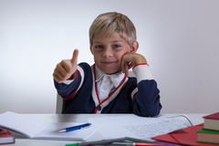 Little student with okay gesture Royalty Free Stock Image