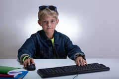 Little student playing on computer Royalty Free Stock Photography