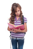 Little student reading interesting book Stock Image