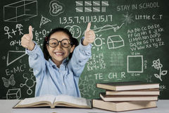 Little student showing ok sign with scribble Stock Photos