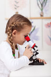 Little student study plants in biology class Stock Photo