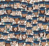 Little students with graduation caps Royalty Free Stock Image