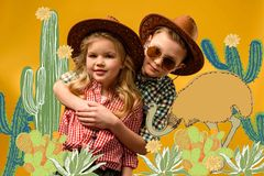 little stylish travelers in hats hugging, on yellow with cactuses royalty free illustration
