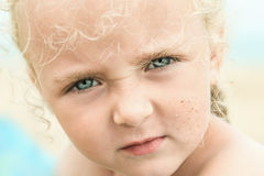 Little summer girl on sea beach royalty free stock photography