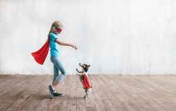 Little super girl with a dog stock image