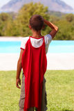 Little super hero looking away, rear view Stock Photography