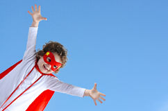Little superhero child girl flies in air Royalty Free Stock Photos