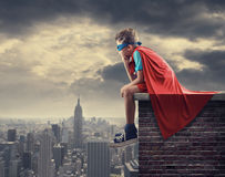 Little Superhero. A young boy dreams of becoming a superhero Royalty Free Stock Images