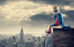 Little Superhero. A young boy dreams of becoming a superhero Stock Photography