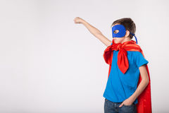 Little superman boy raised his hand up Stock Photos