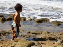 Little surfer. A little boy at the beach Stock Photography