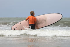 Little surfer Stock Images