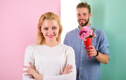 Little surprise for her. Boyfriend bring bouquet flowers to surprise her. Man ready for perfect date. Girl waiting for royalty free stock image