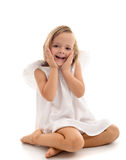 Little surprised angel sitting Stock Images