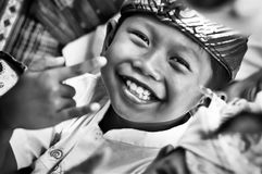 Little sweet Balinese boy smiling with hand gesture `I Love You` Stock Photos