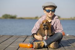 Child hugging his dog royalty free stock photography