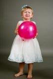 Little sweet crying girl with balloon Stock Image