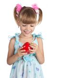 A little sweet girl with a red pepper Stock Photo