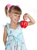 A little sweet girl with a red pepper Stock Image