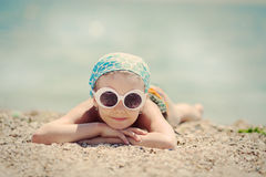 Little sweet girl resting on the beach Royalty Free Stock Photos