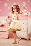 Little sweet girl with tea Royalty Free Stock Photos