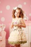 Little sweet girl with tea Stock Photo