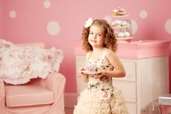 Little sweet girl with tea Stock Photos